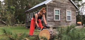 Working with other Scientology volunteer ministers in North Carolina, taking a chainsaw to fallen trees after the hurricane